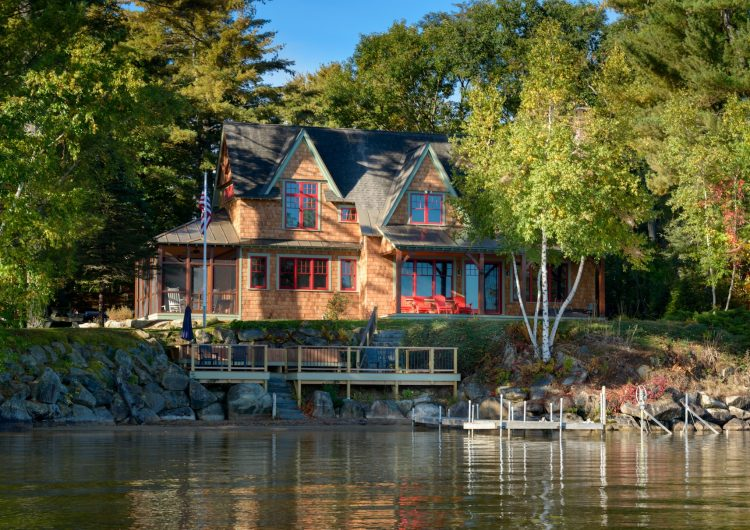 Overlooking the Winnisquam with wonderful breezeway and all wood finish interior