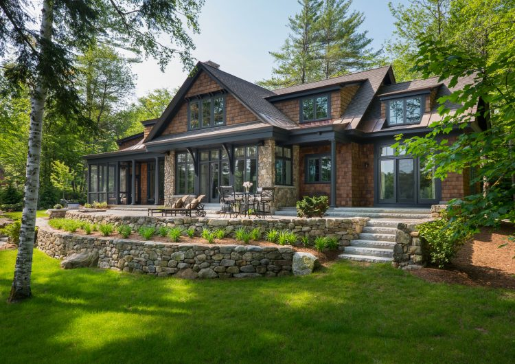 Situated in, New London NH, this design-build features a great room leading to a patio overlooking Lake Sunapee,