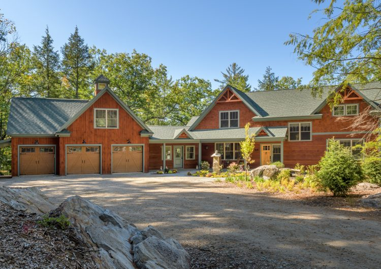 Overlooking Blaisdell Lake lake NH this Custom Home brings together a design-build approach with wonderful wood craftsmen