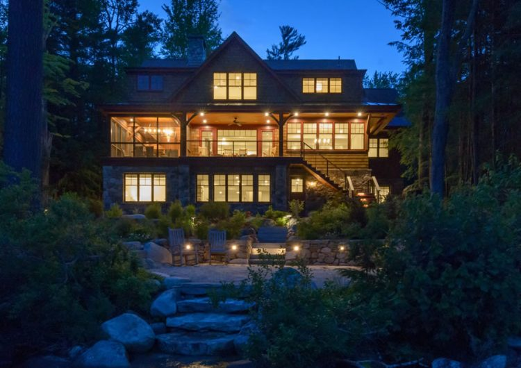 Steps away from Lake Sunapee with brilliant woodcraft in and out with unique breezeway feet from the water